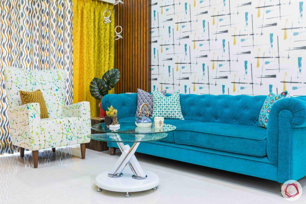 livspace mumbai-3-bhk-in-mumbai-living room-seating-blue sofa-accent chair