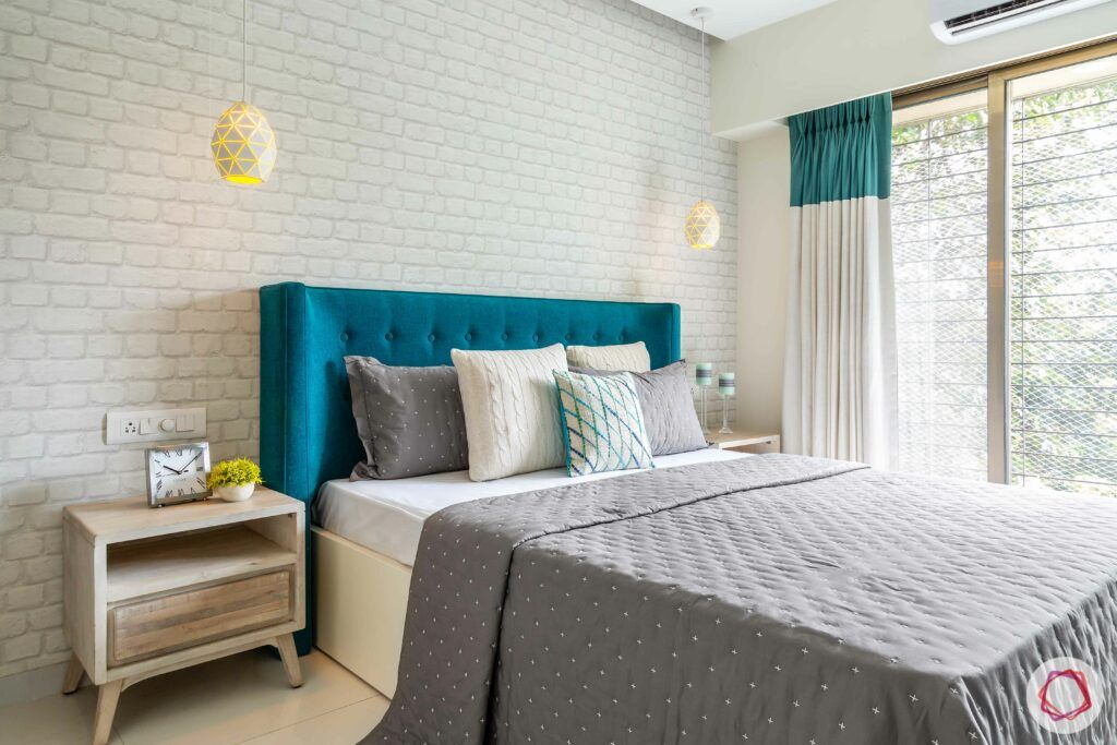 modern bedroom design-exposed brick wall-aqua headboard-side table-pendant lights