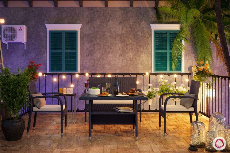 flat balcony ideas-fairy lights-coffee table-chairs
