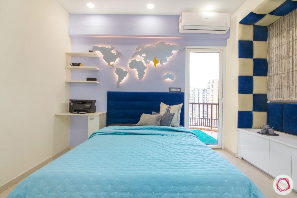 dasnac-blue bedroom-world-map-stencil-blue-headboard