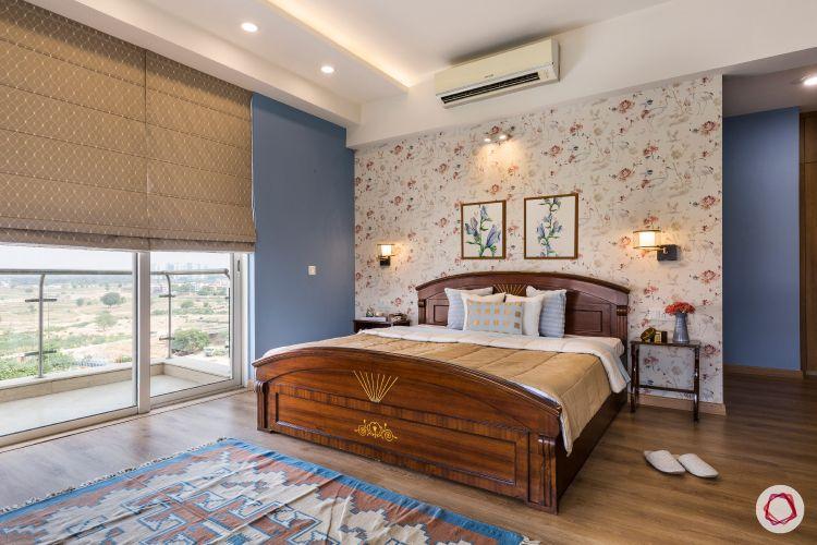 teak wood bed-floral wallpaper-blue walls