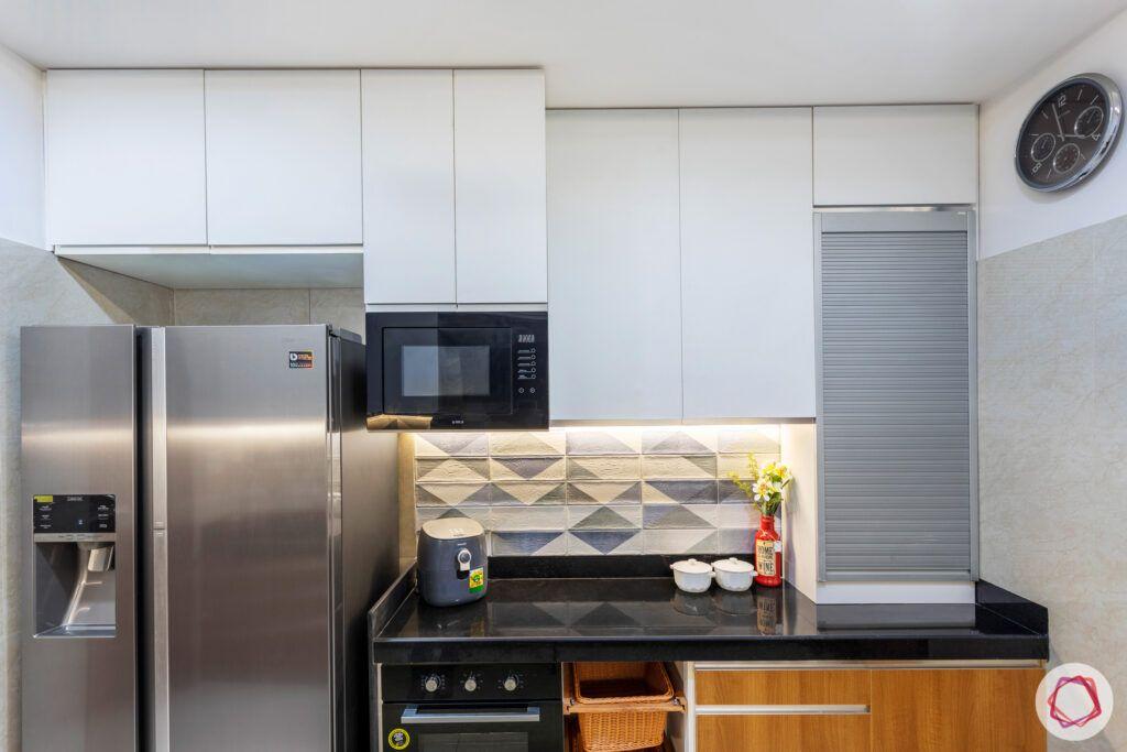 crescent-bay-parel-kitchen-cabinets-fridge-roller-shutter