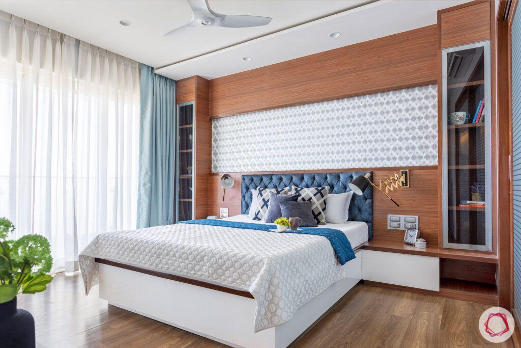 bedroom-blue-headboard-wallpaper-cabinet-wooden-floor