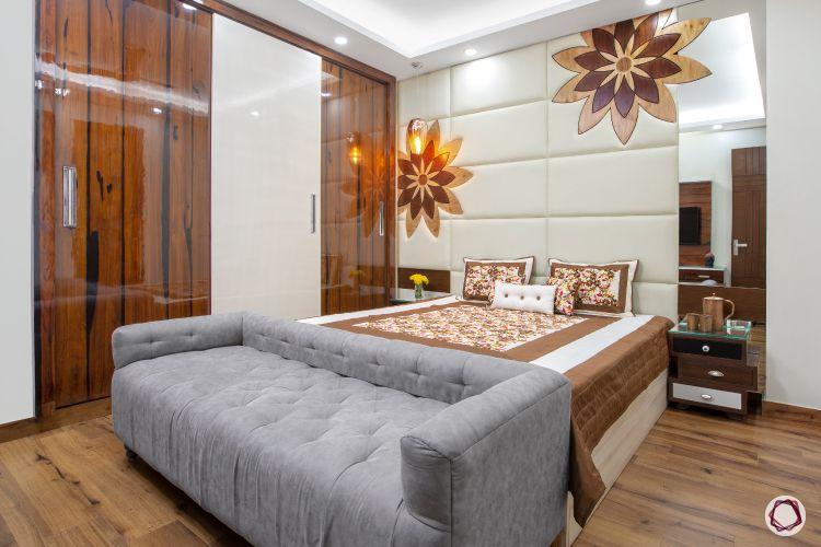 bedroom sofa-grey sofa-patterned headboard-mirror-wardrobe