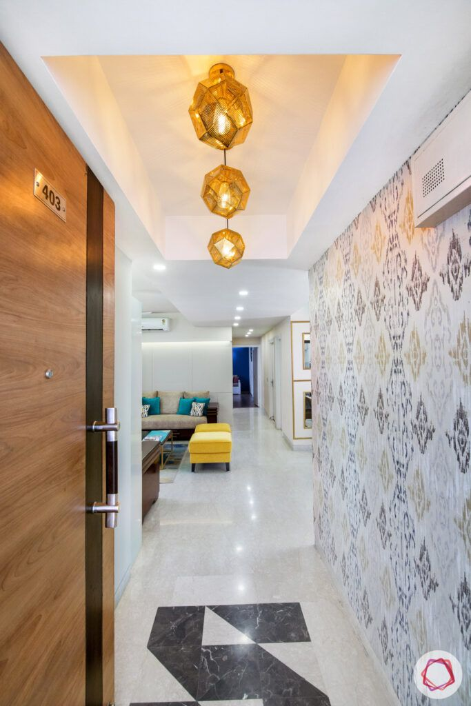 foyer-lighting-quirky-wallpaper-yellow-sofa-false-ceiling