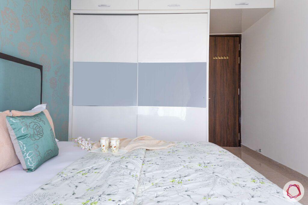 white and silver wardrobe designs-green wallpaper-silver motifs