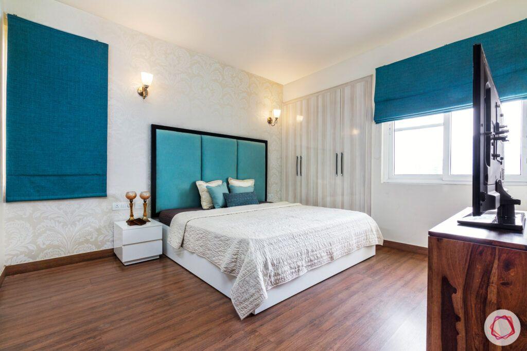 house in gurgaon-wooden flooring designs-teal headboard designs