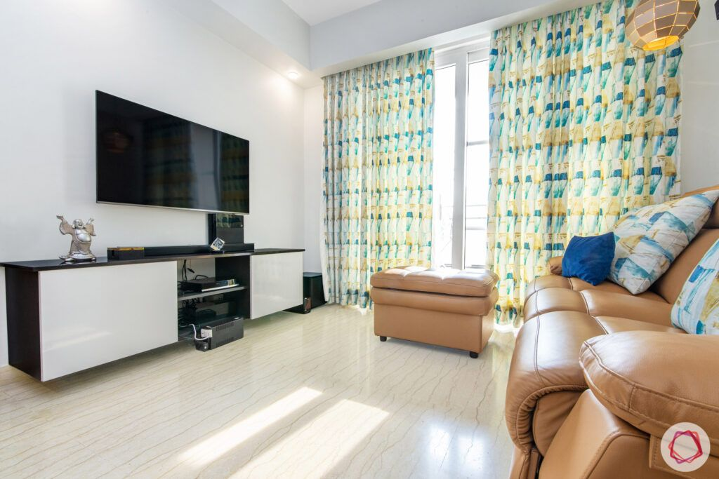 house in gurgaon-brown leather sofa-white tv unit