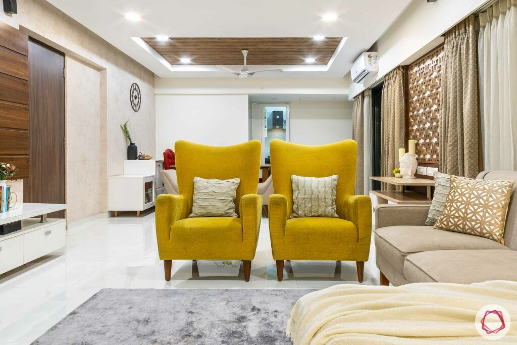 apartment interior design-living room-yellow accent chairs
