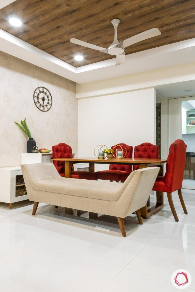 apartment interior design-dining room-bench-red chairs