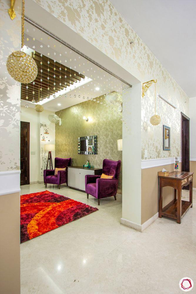 prestige-white-meadows-foyer-wooden-rafters-red-carpet-purple-armchair