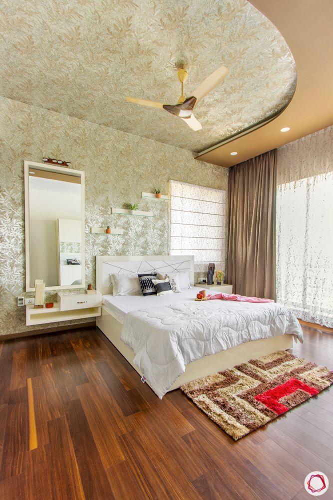 prestige-white-meadows-master-bedroom-false-ceiling-dresser-bed-wooden-floor