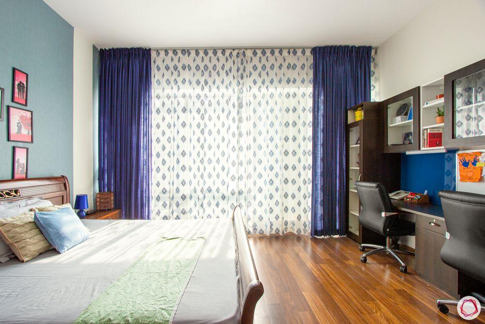 guest-bedroom-study-blue-curtains-wooden-floor