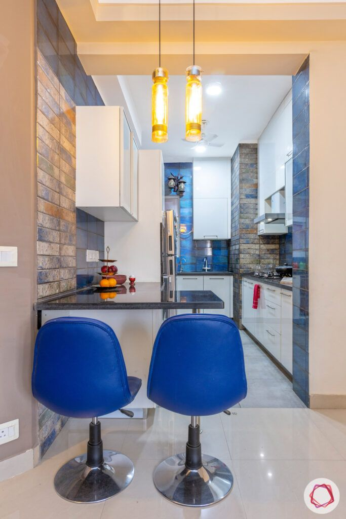 blue bar chairs-pendant lights-granite countertop
