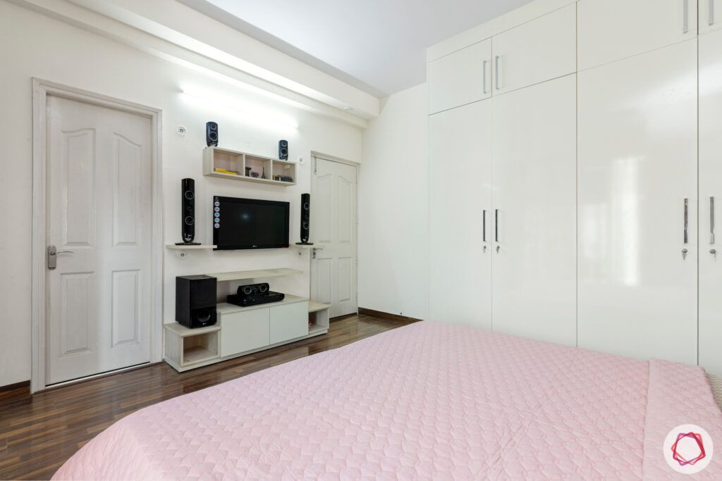 mapsko royale ville-white tv unit-white wardrobes- Champagne white wardrobes-wooden flooring