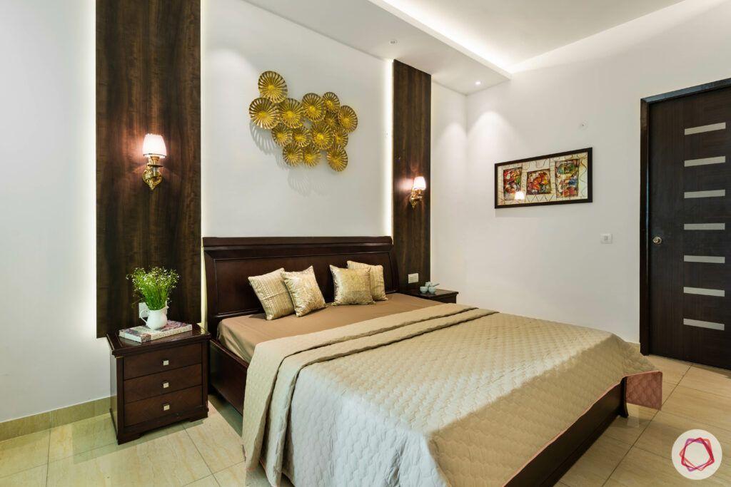 wooden panels-dark wood bed-white walls-cream walls-golden wall art