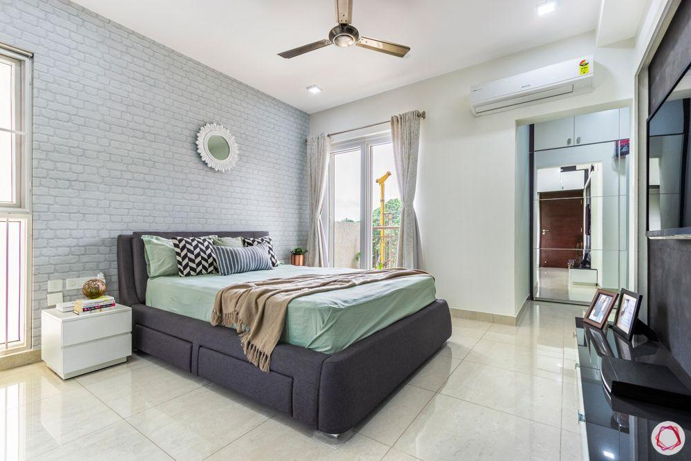 apartment interior-master bedroom-exposed brick wallpaper-mirror-dresser