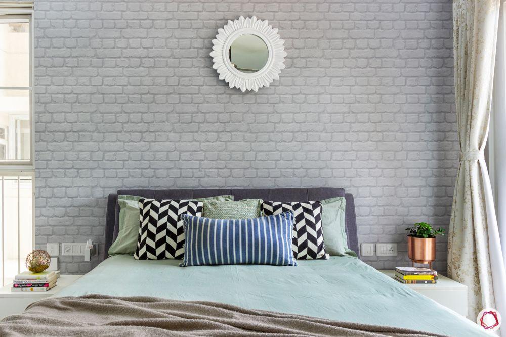 apartment interior-exposed brick wallpaper-mirror-bedroom
