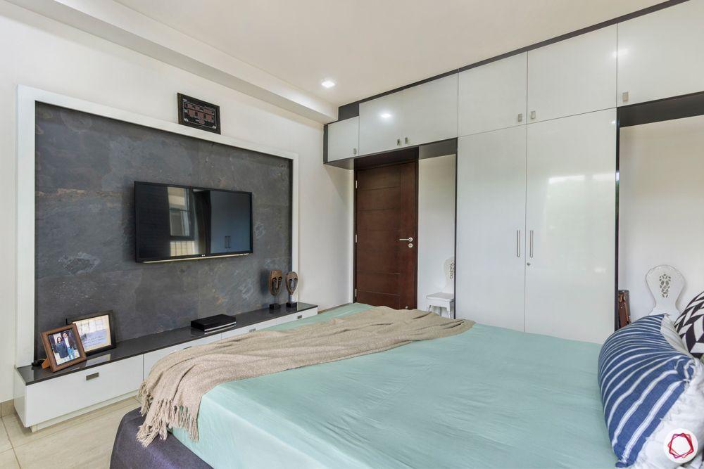apartment interior-TV unit-stone veneer tv unit-master bedroom