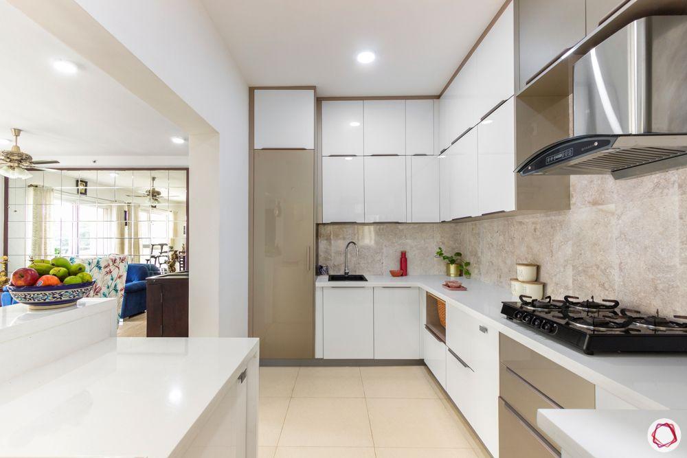 apartment interior-kitchen-drawers-white and beige acrylic finish-kalinga stone countertop