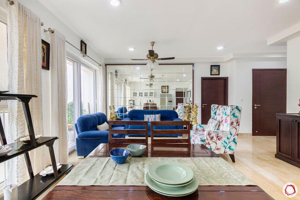 living room-mirror wall-blue sofa-accent chair