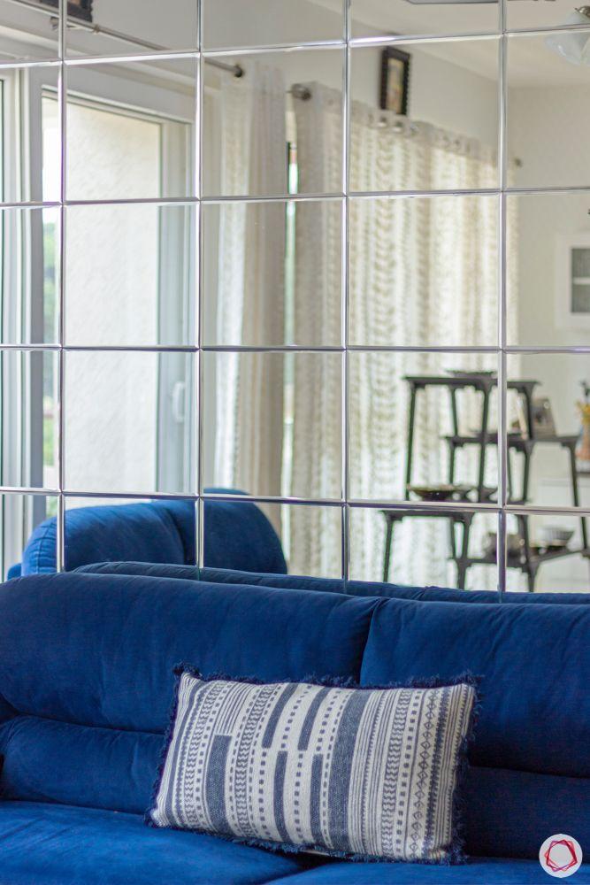 apartment interior-mirror cladding-blue sofa