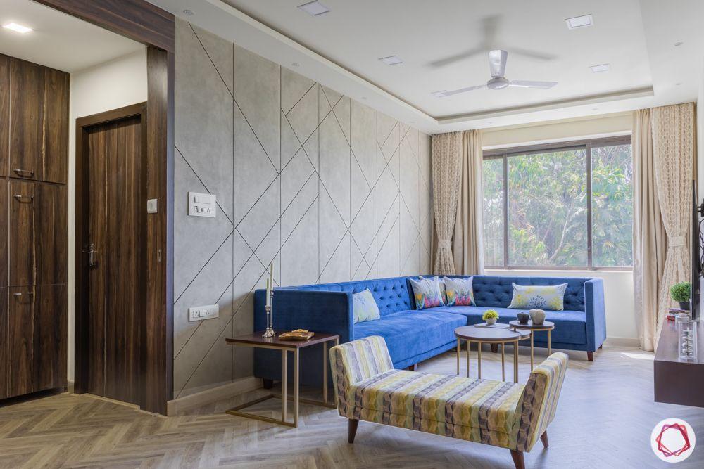 interior design for 2bhk flat in mumbai-living room-blue sofa-printed bench