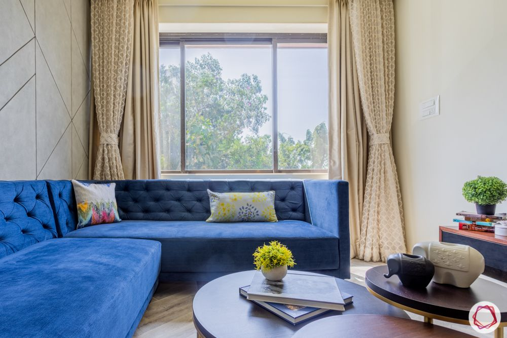 interior design for 2bhk flat in mumbai-living room-l shaped sofa-blue chesterfield sofa