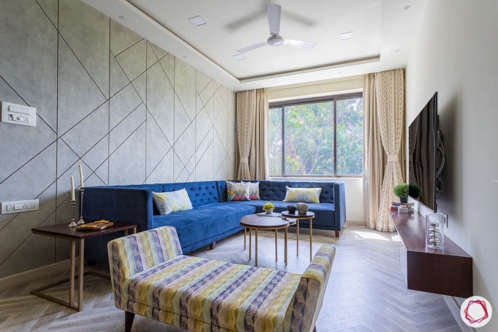 interior design for 2bhk flat in mumbai-living room-concrete texture paint-wall panels