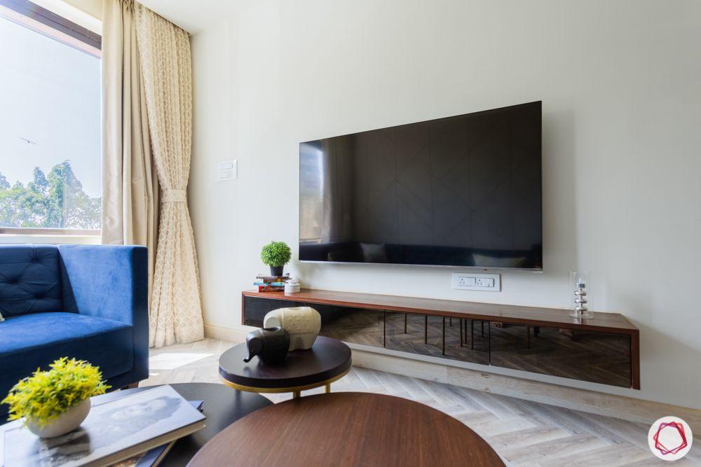 interior design for 2bhk flat in mumbai-living room-tinted glass-tv unit