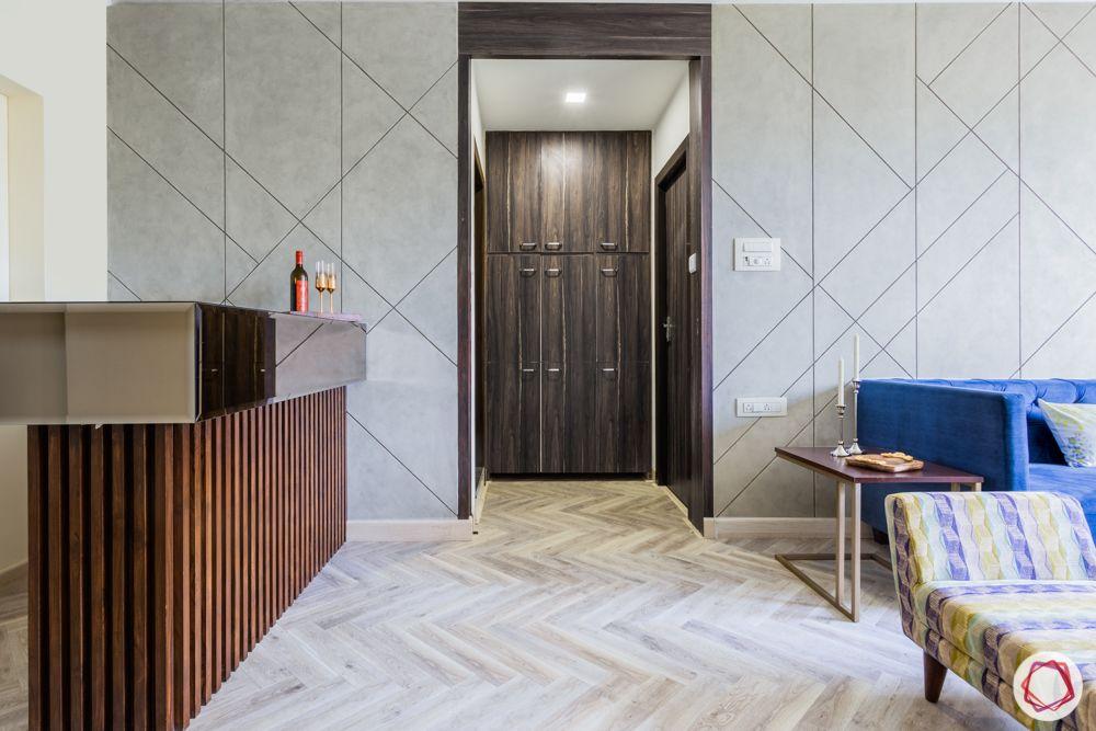 interior design for 2bhk flat in mumbai-herringbone flooring-storage cabinets
