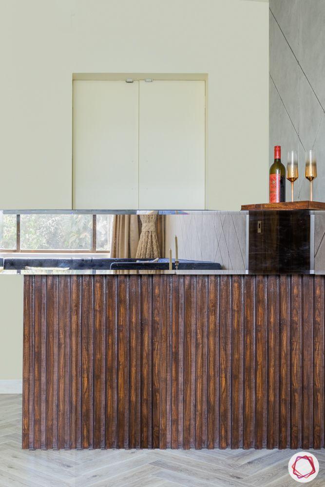 flat interiors-bar counter-veneer bar unit-tinted glass panel