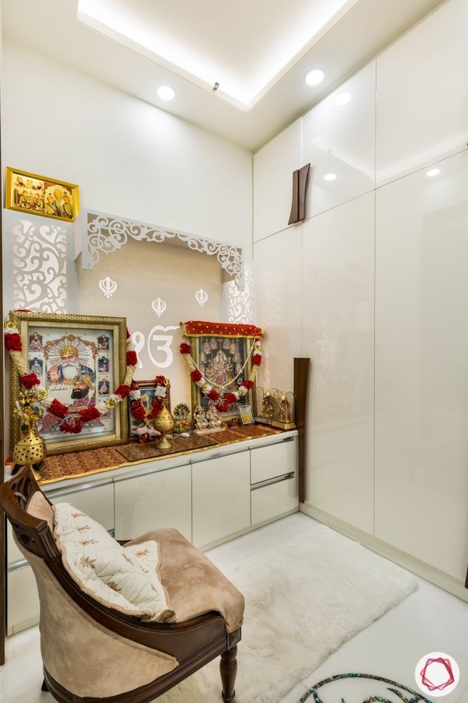pooja mandir for home designs-white cabinets-high-gloss wardrobes-chair in pooja room