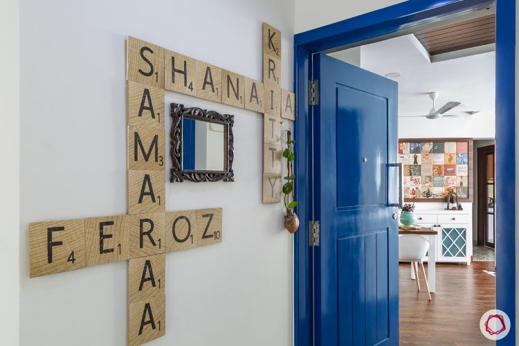 door-colours-blue-glossy-nameplate-mirror-plants-wooden-flooring