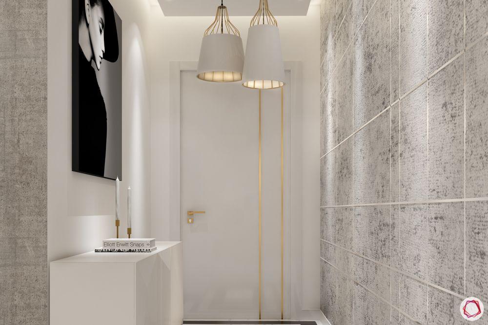 white-door-gold-strips-blank-floor-textured-wall-console-table-light-fixtures