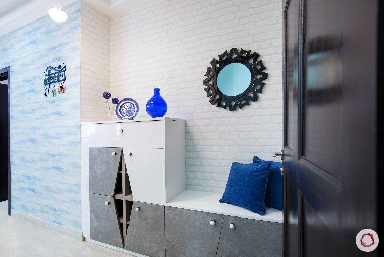 exposed brick wall designs-round mirror designs-blue wallpaper designs