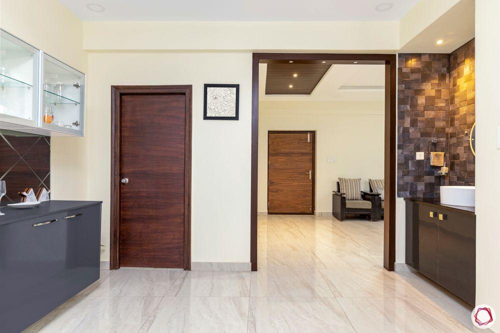 hallmark-tranquil-wooden-false-ceiling-spotlights-white-flooring