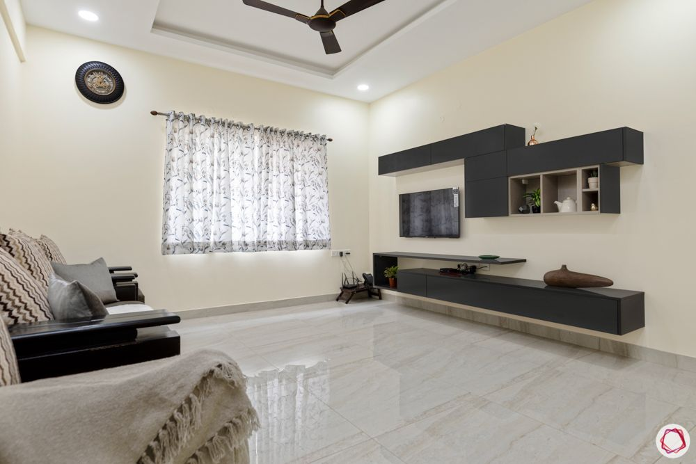 hallmark-tranquil-living-room-TV-unit-sofa-false-ceiling