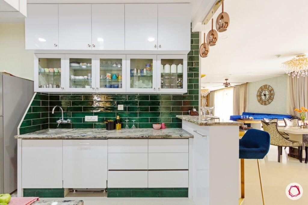 hiranandani bangalore-green kitchen tiles-white kitchen cabinets