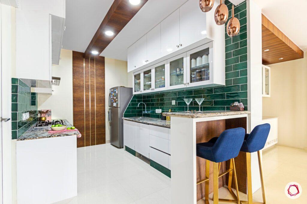 green kitchen tiles-wooden ceiling details