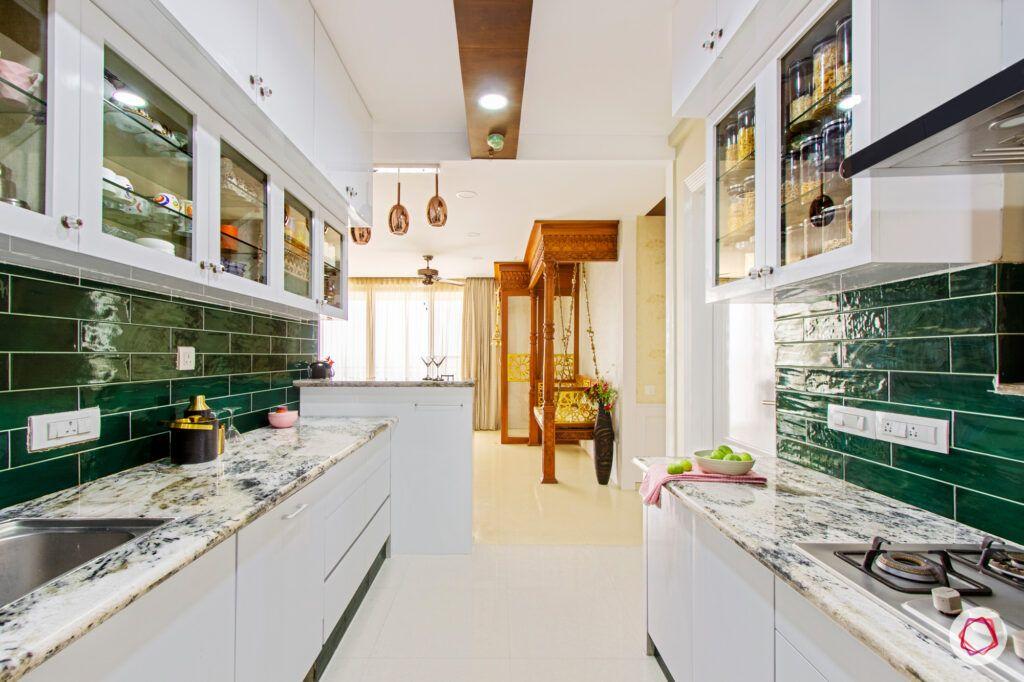 green kitchen tiles-white granite countertops