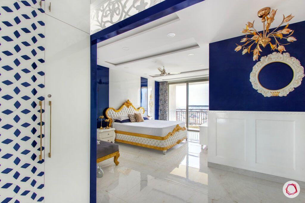 hiranandani bangalore-blue wall ideas-white wood carving