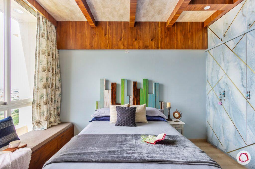hiranandani bangalore-rustic ceiling designs-wooden headboard designs