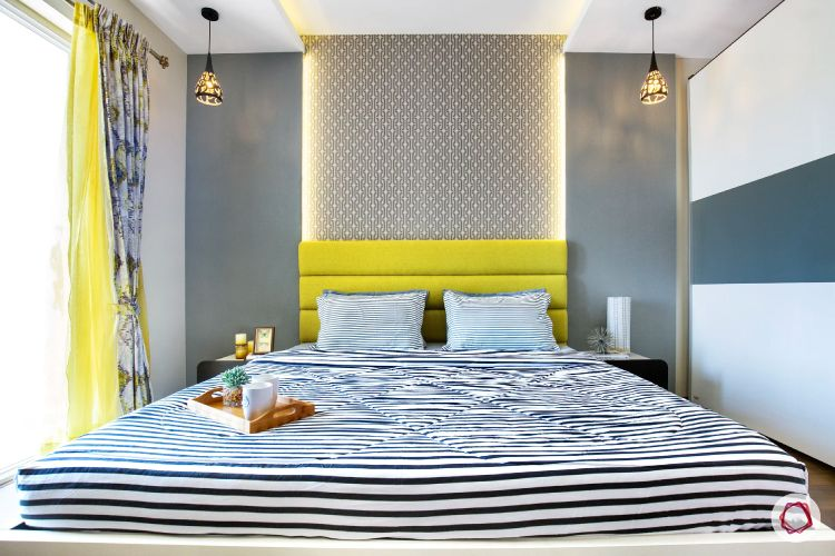 bedroom accent wall-backlighting-yellow headboard-grey wall paint-pendant lights