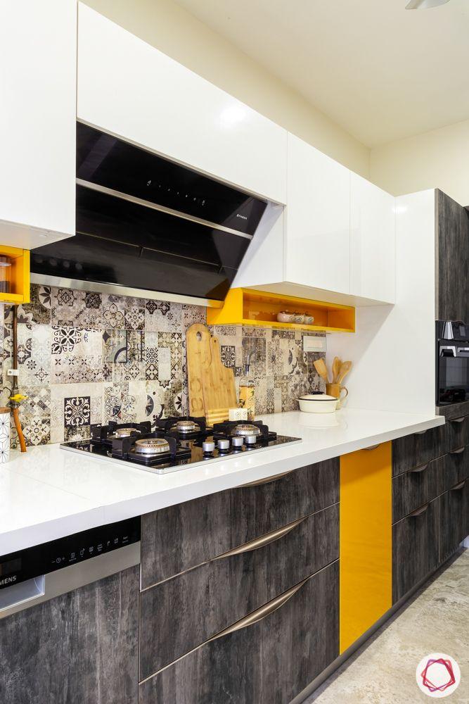 home renovation mumbai-orange shelf-white and grey cabinets