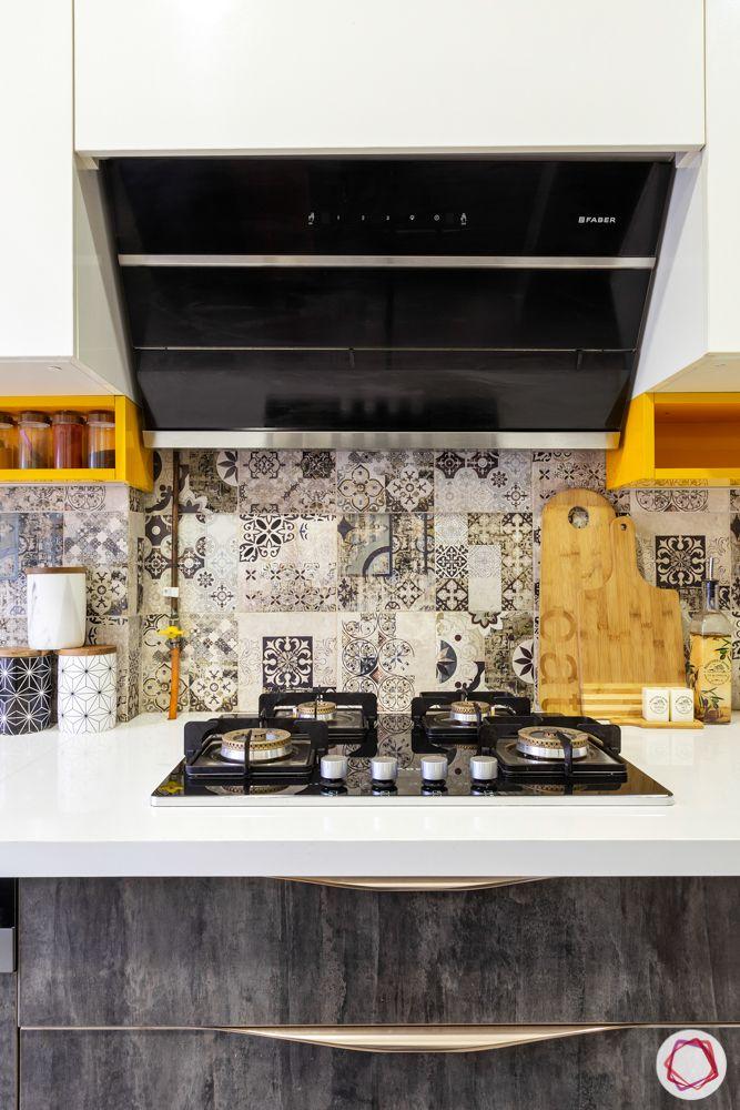 home renovation mumbai-moroccan tiles-hob-orange cabinets