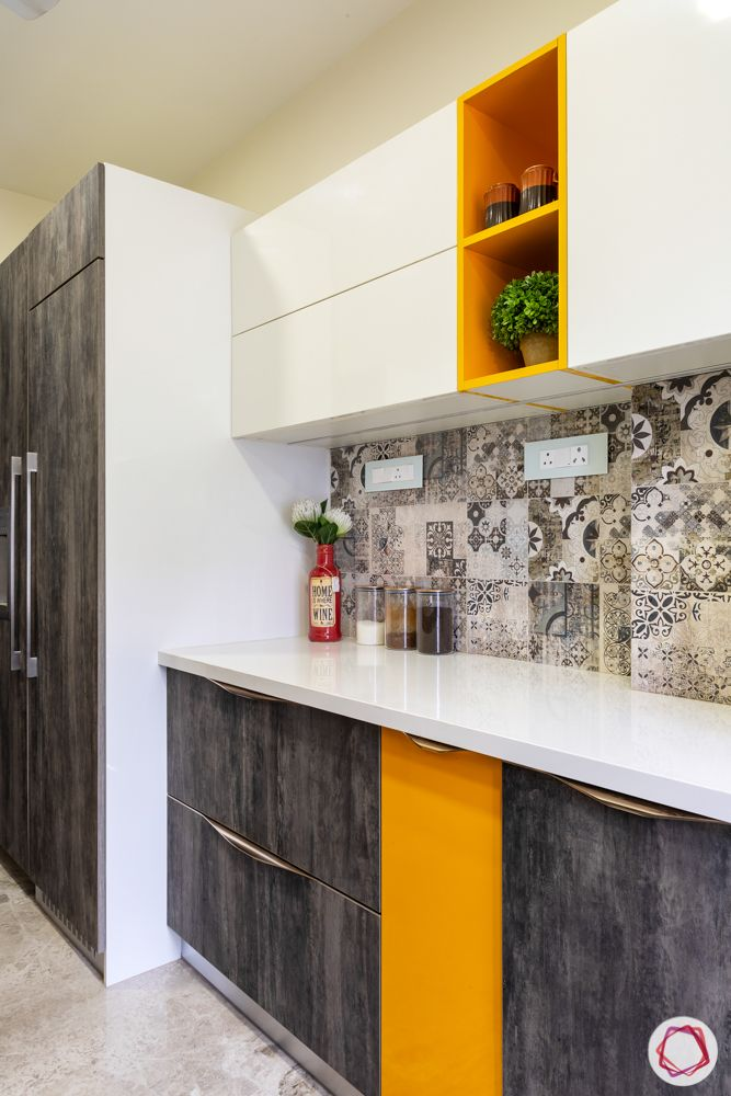 home renovation mumbai-moroccan backsplash-white cabinets-orange shelves