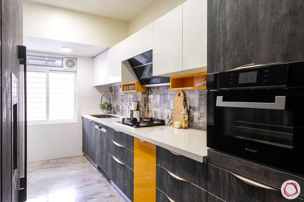home renovation mumbai-yellow cabinets-white cabinets-stone finish cabine