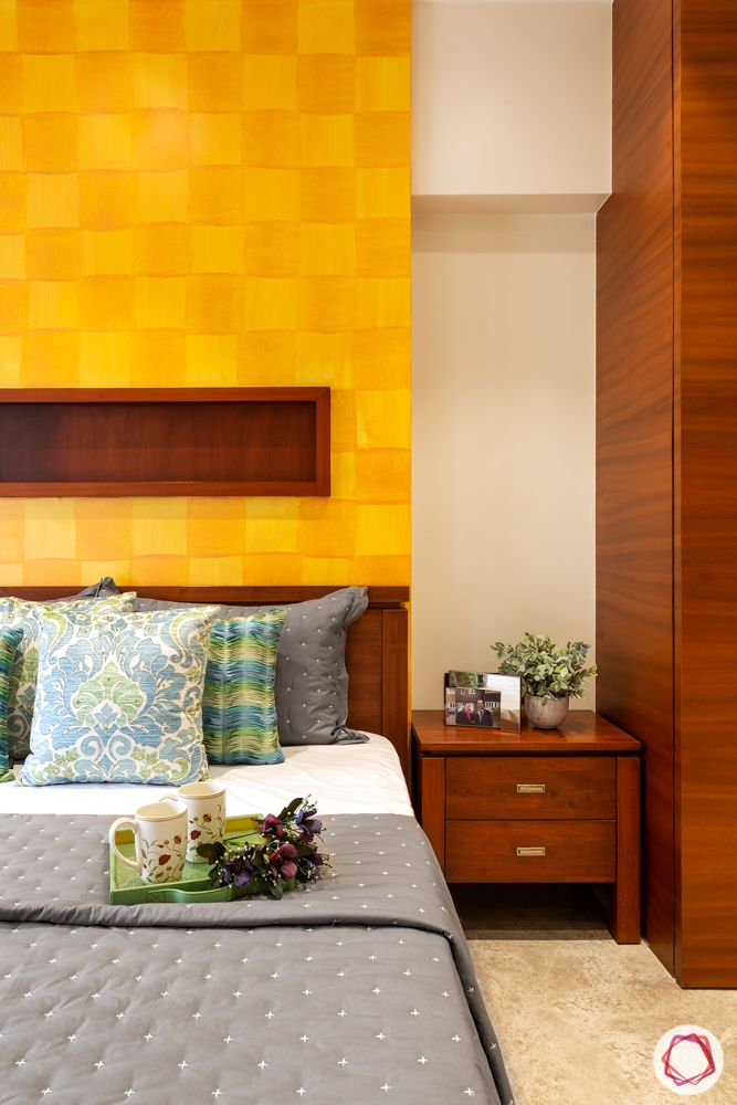 home renovation mumbai-yellow wall-wooden wardrobe-wooden bed
