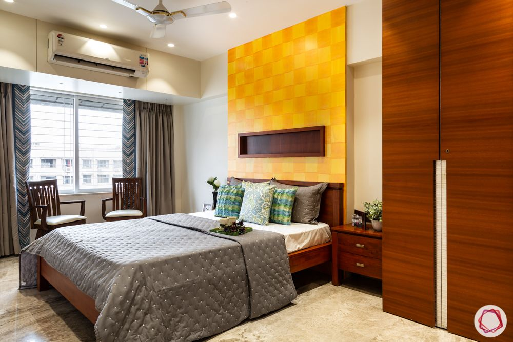 home renovation mumbai-yellow accent wall-wooden wardrobe designs-window seating